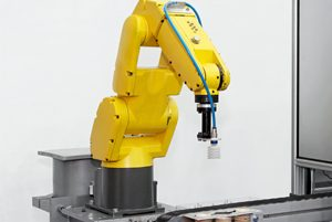 Picture of a robotic arm of a product line
