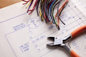 Electrical Wiring with wire cutters and blueprints