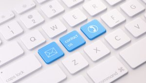 Modern White Keyboard wih Three Blue Colored Contact Us Buttons